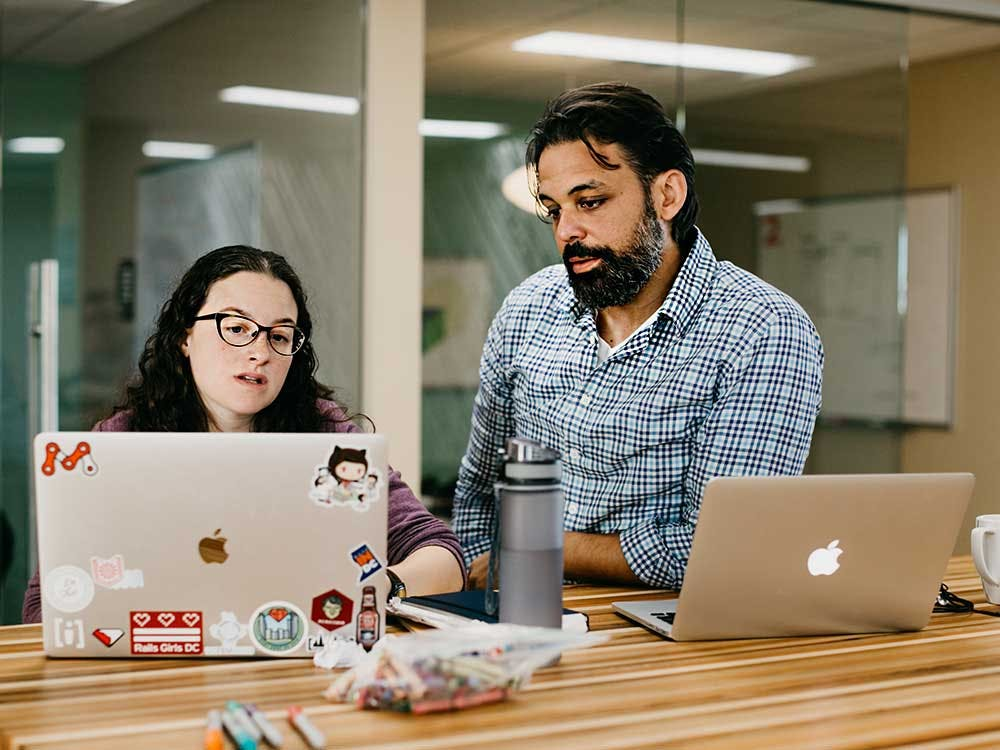 Photo of Allison and Eric reviewing code