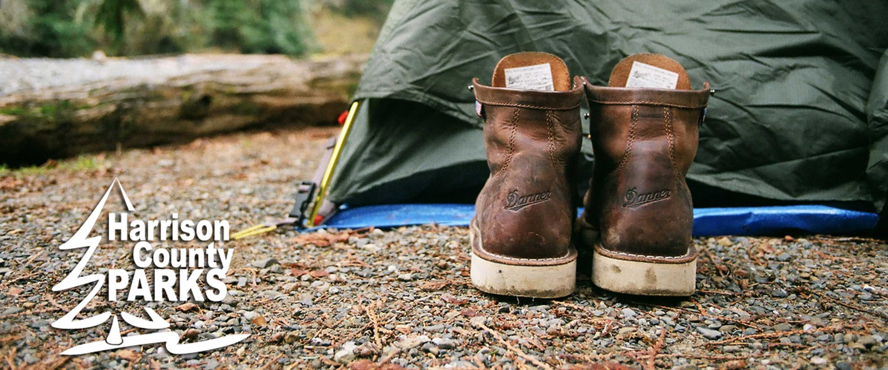 hiking boots outside a tent