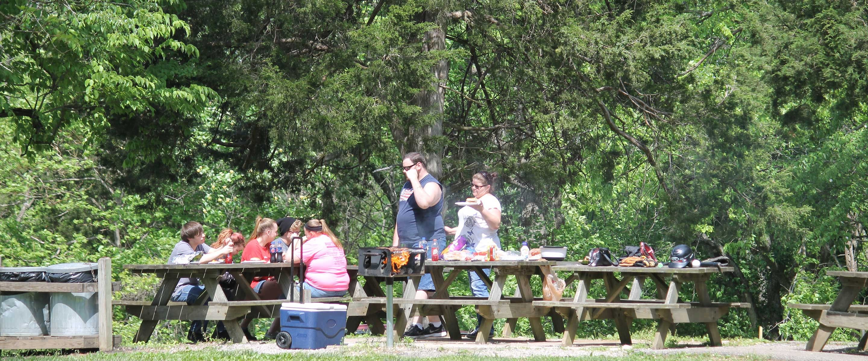 Couple enjoying a grilled meal at one of the picnic tables