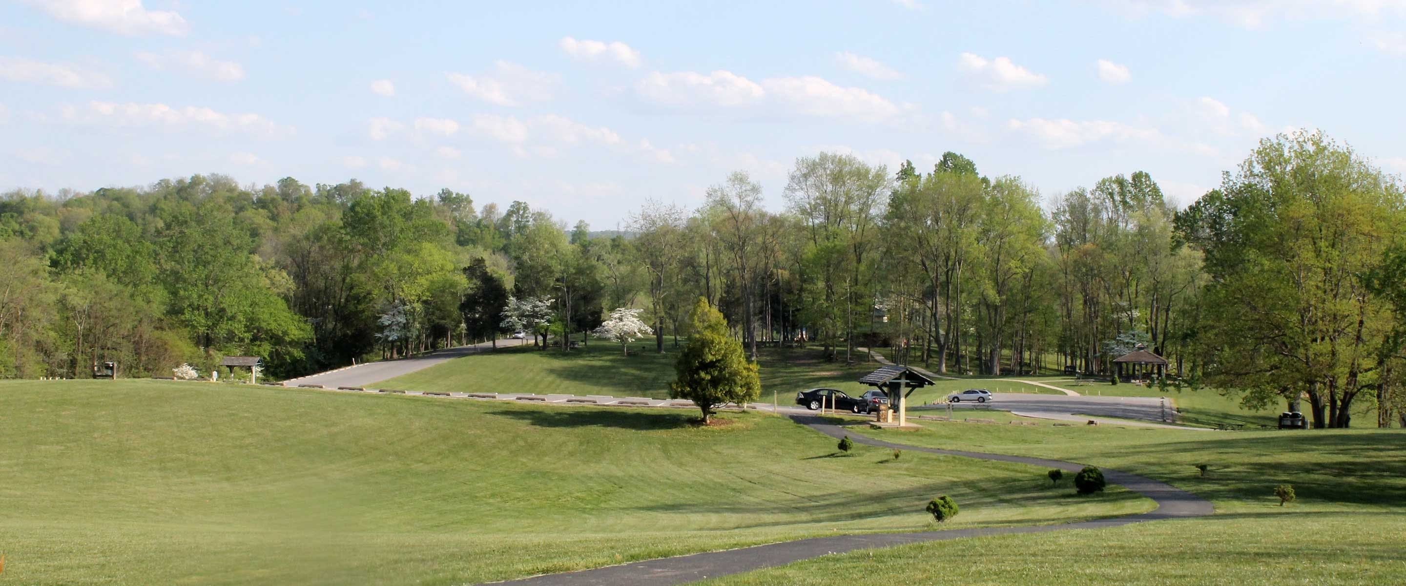 Panoramic view of hillside and paved trail at Hayswood Nature Preserve