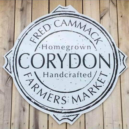 circular sign that says Fred Cammack Farmers' Market with Corydon in the middle
